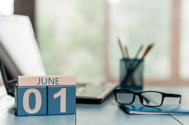 june 1st. day of the month 1 , wooden color calendar on business workplace background. summer concept. empty space for text - june stock photos and pictures