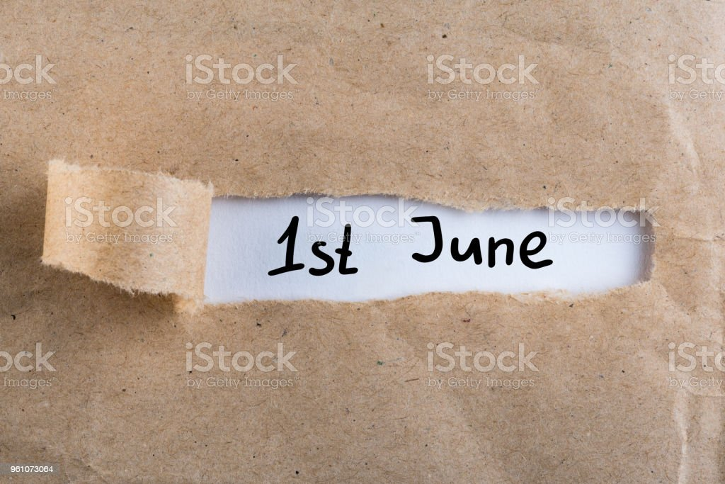 June 1st. Image of june 1 calendar on torn envelope background. First summer day. Happy Childrens Day stock photo