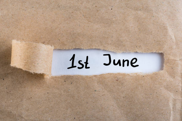 june 1st. image of june 1 calendar on torn envelope background. first summer day. happy childrens day - june stock photos and pictures