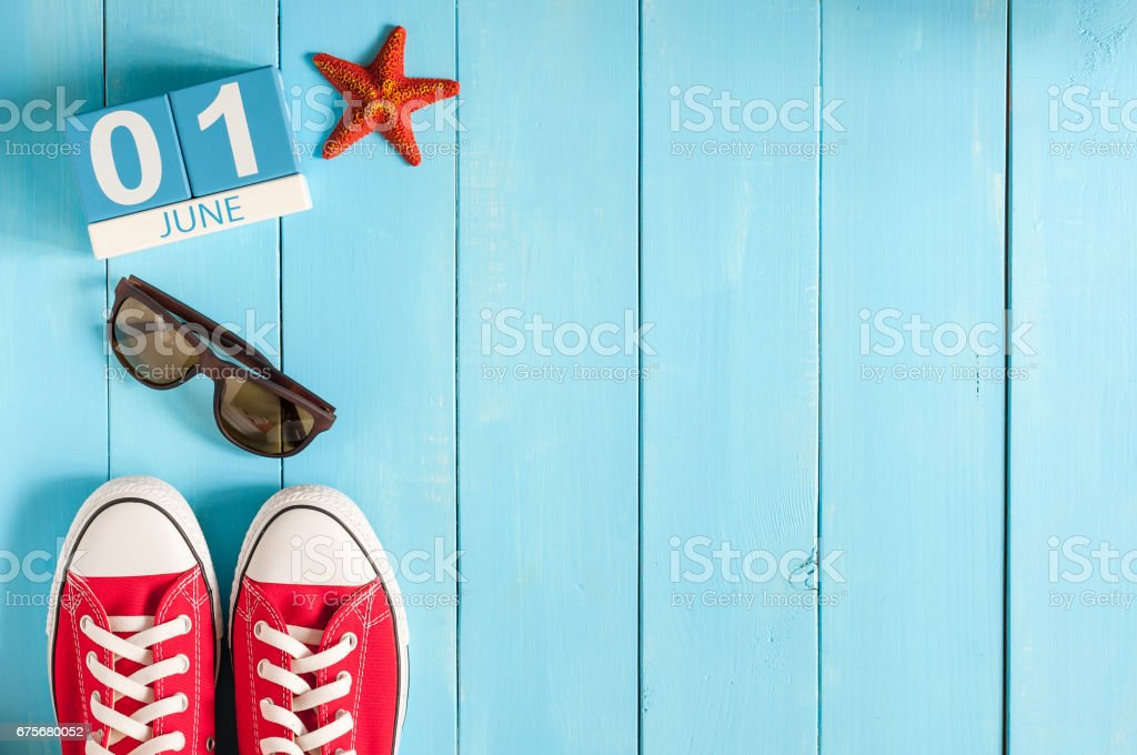 June 1st. Image of june 1 wooden color calendar on blue background.  First summer day. Empty space for text. Happy Childrens Day royalty-free stock photo