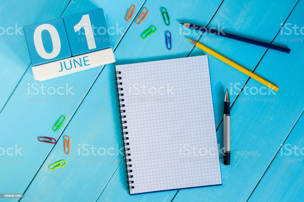 June 1st. Image of june 1 wooden color calendar on blue background.  First summer day. Empty space for text. Happy Childrens Day stock photo