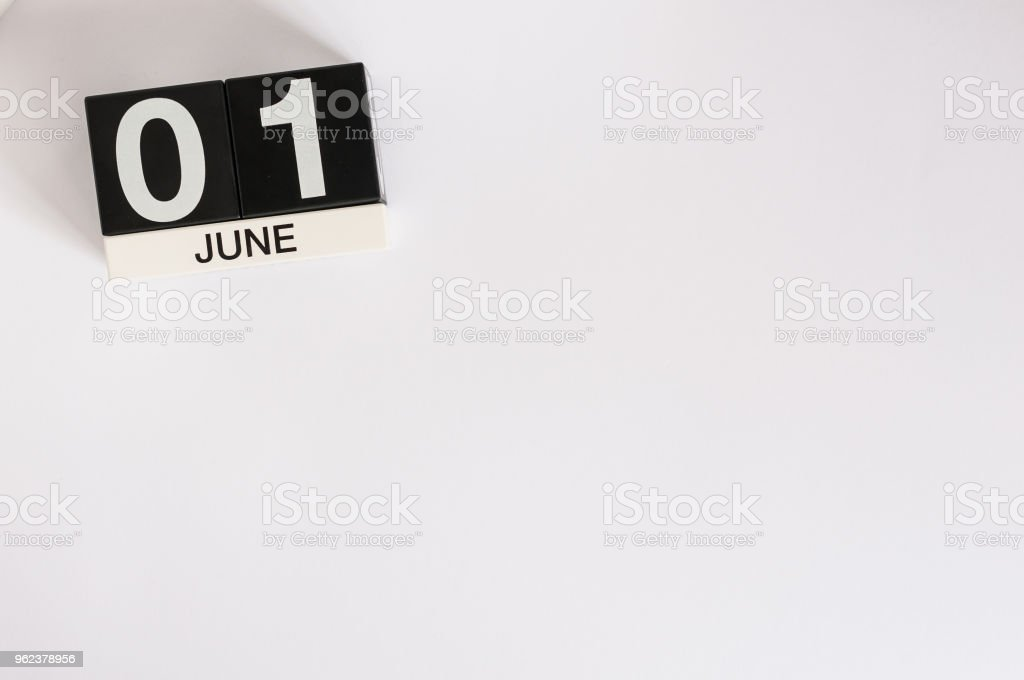 June 1st. Image of june 1 wooden color calendar on white background.  First summer day. Empty space for text. Happy Childrens Day stock photo