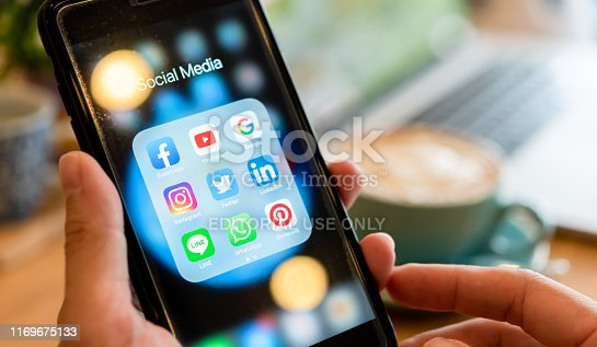 istock BANGKOK, THAILAND- 25 June 2019 : Hands of man use Iphone 7 plus with social media application of facebook, youtube, google search, instagram, twitter, linked in, line whatsapp, and pinterest 1169675133