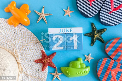 June 21st. Image of june 21 calendar on blue background with summer beach, traveler outfit and accessories. Summer day.