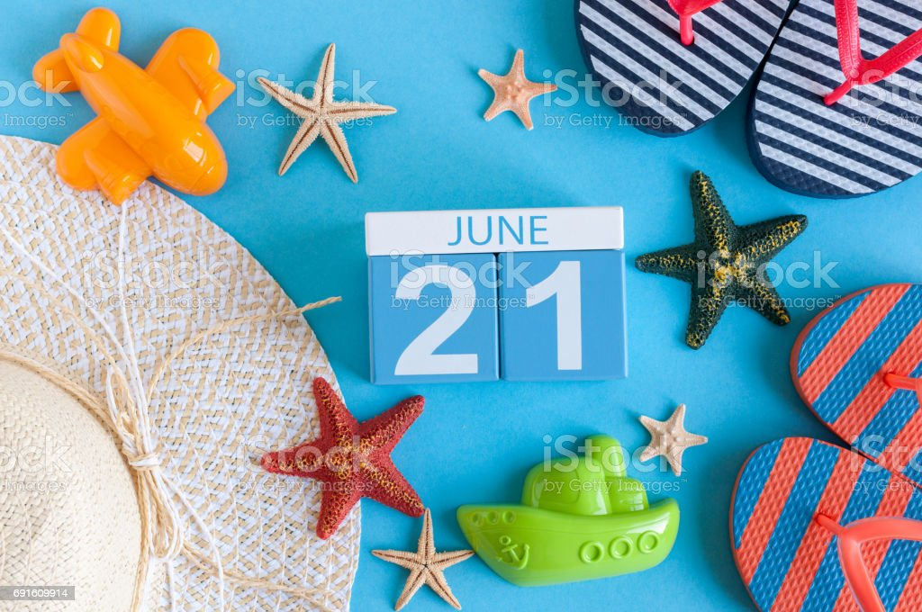 June 21st. Image of june 21 calendar on blue background with summer beach, traveler outfit and accessories. Summer day stock photo