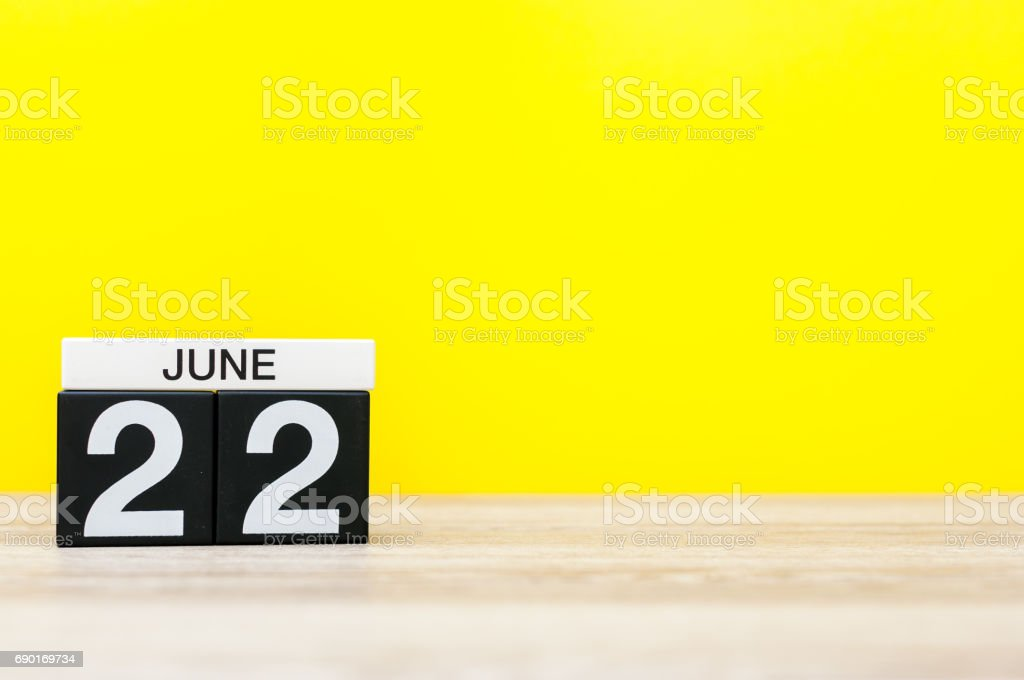 June 22nd. Day 22 of month, calendar on yellow background. Summer day. Empty space for text stock photo