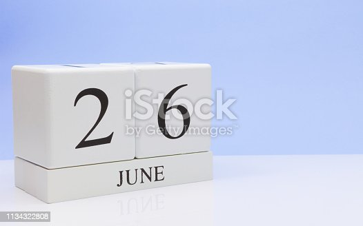 istock June 26st. Day 26 of month, daily calendar on white table with reflection, with light blue background. Summer time, empty space for text 1134322808