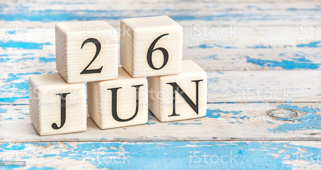 June 26th. Wooden cubes with date of 26 June on old blue wooden background. stock photo