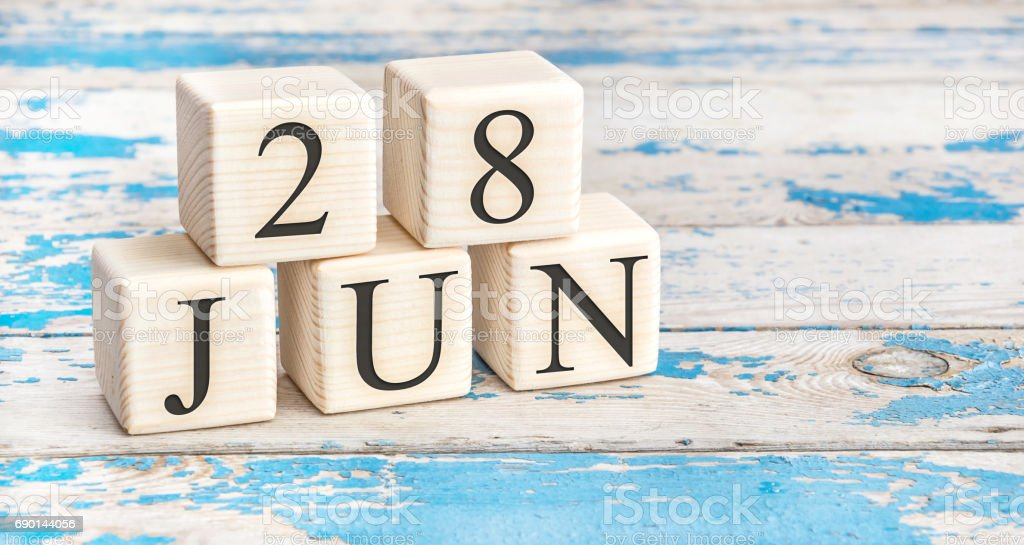 June 28th. Wooden cubes with date of 28 June on old blue wooden background. stock photo