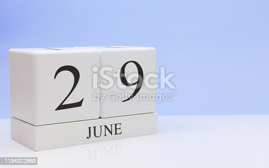 istock June 29st. Day 29 of month, daily calendar on white table with reflection, with light blue background. Summer time, empty space for text 1134322863