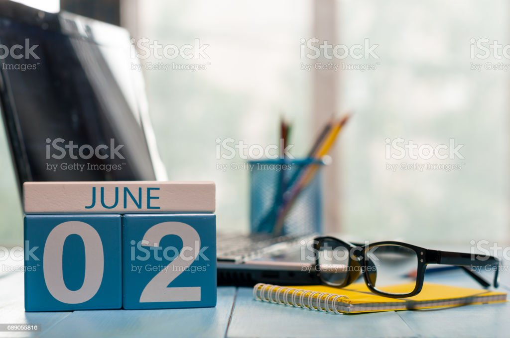 June 2nd. Day of the month 2 wooden color calendar on business workplace background. Summer concept. Empty space for text stock photo