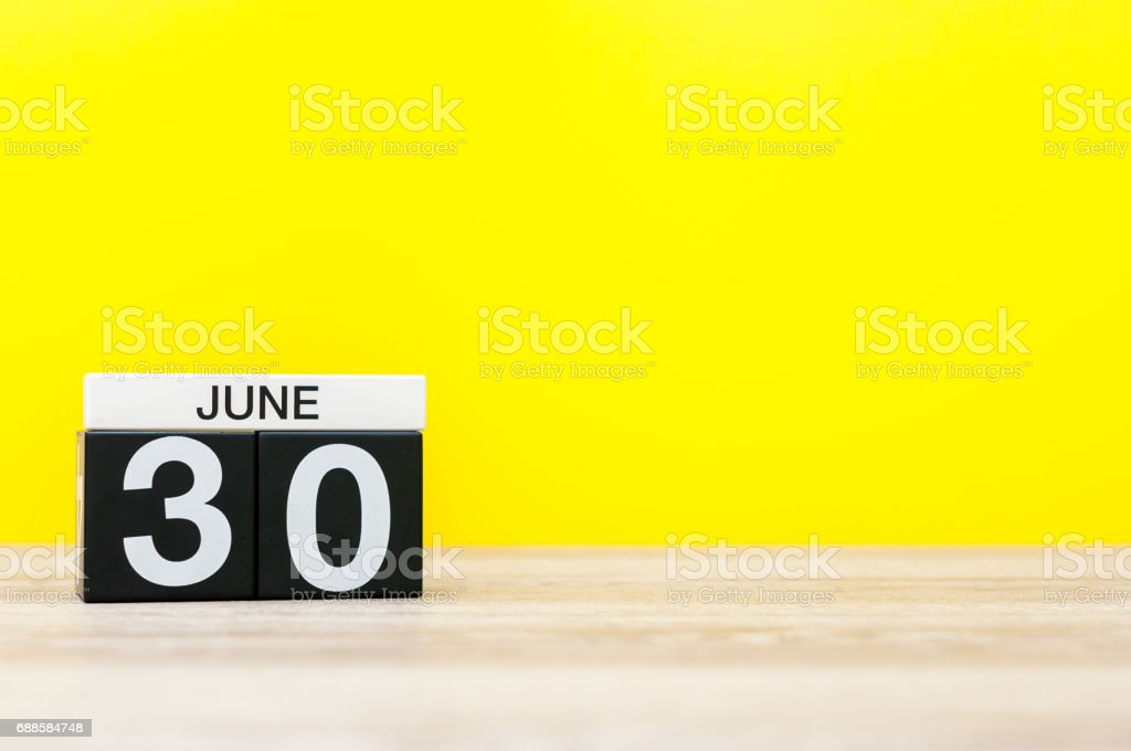 June 30th. Day 30 of month, calendar on yellow background. Summer day. Empty space for text stock photo