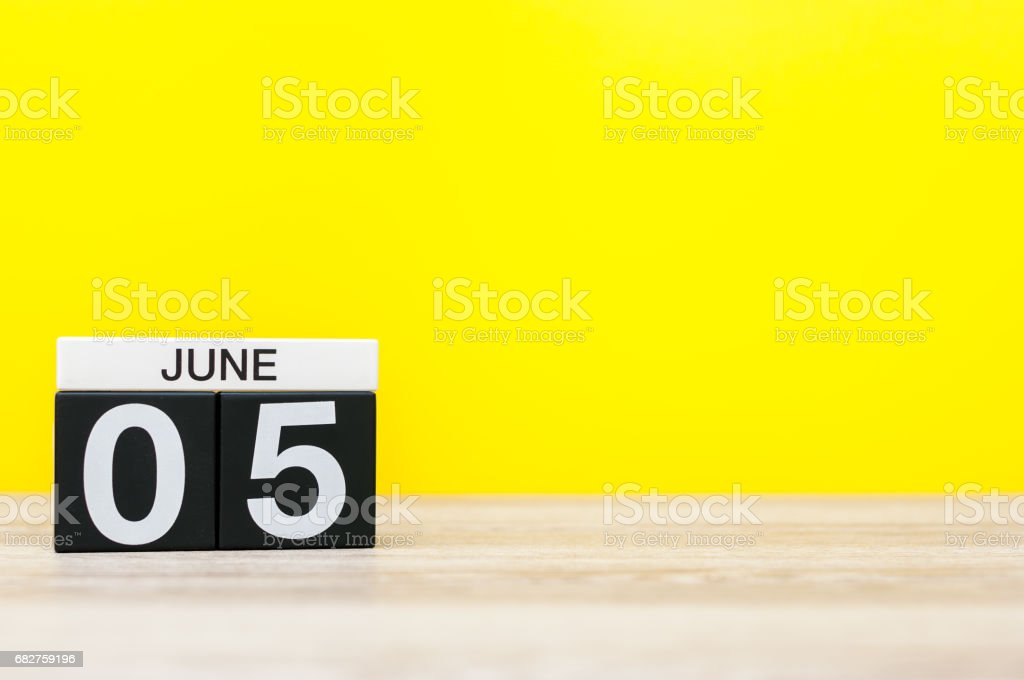 June 5th. Day 5 of month, calendar on yellow background. Summer day, empty space for text. International Cleanup Day stock photo