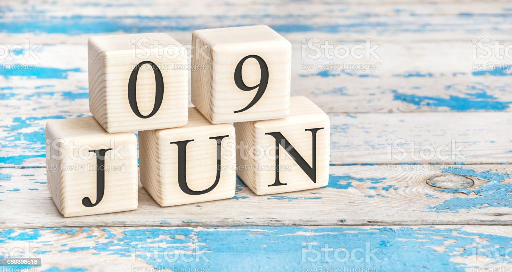 June 9th. Wooden cubes with date of 9 June on old blue wooden background. royalty-free stock photo