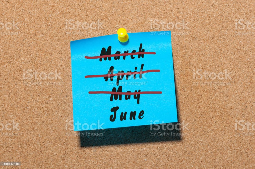 June - First summer month beginning. Crossed out March, April and May monthes at blue sticker pinned to notice board. Hello june concept. Happy Childrens Day stock photo