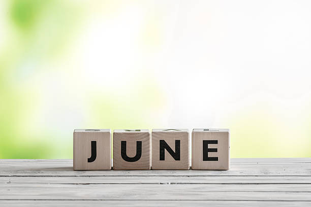 june sign on wooden blocks - june stock photos and pictures