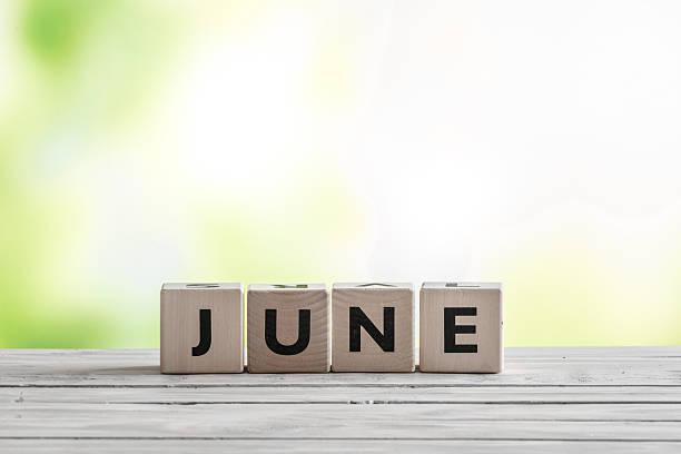 June sign on wooden blocks stock photo