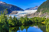 Juneau, Alaska. Mendenhall Glacier Viewpoint with reflection in the lake.
