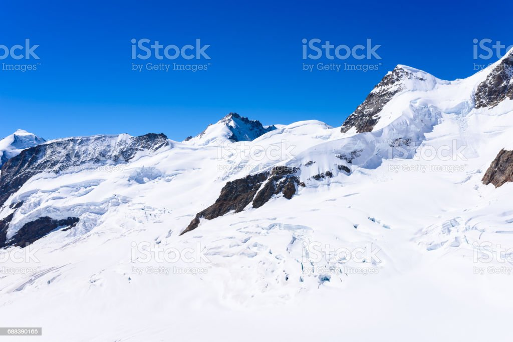 Jungfrau mountain - View of the mountain Jungfrau in the Bernese Alps in Switzerland stock photo