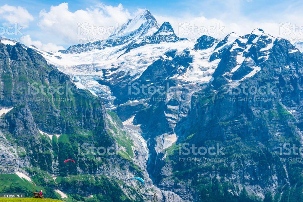 Jungfrau-Aletsch-Bietschhorn UNESCO World Natural Heritagei n summer. Skydivers and tourists. stock photo