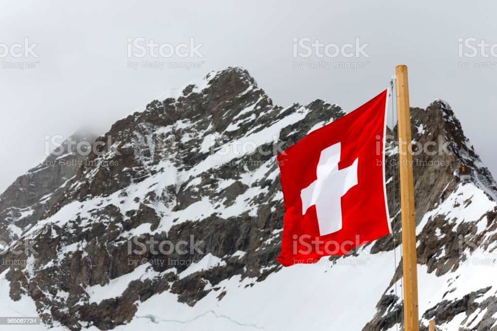Jungfraujoch Swiss Alps with Flag, Switzerland zbiór zdjęć royalty-free