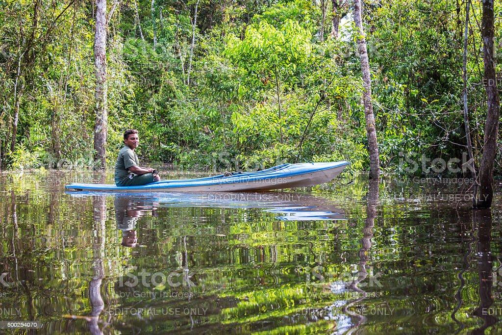 Jungle Guide in a Canoe stock photo