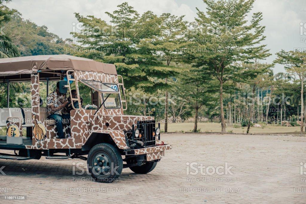 Jungle safari at a zoo. Safari car in a zoo