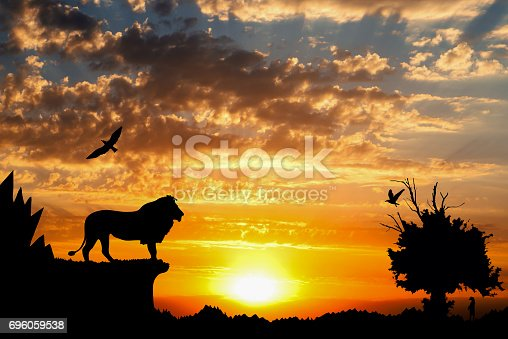 istock Jungle with mountains, old tree, birds lion and meerkat on golden cloudy sunset background 696059538
