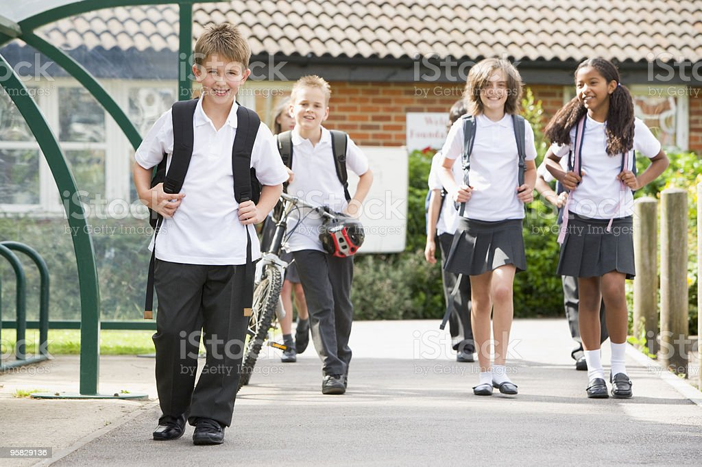 Junior children leaving school royalty-free stock photo