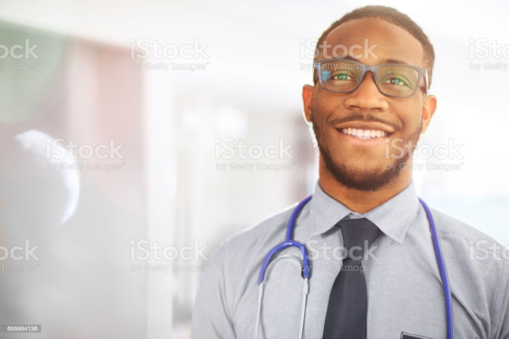 Junior doctor smiling to camera in hospital stock photo