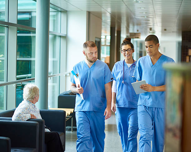 junior doctors - doctors and nurses stock photos and pictures
