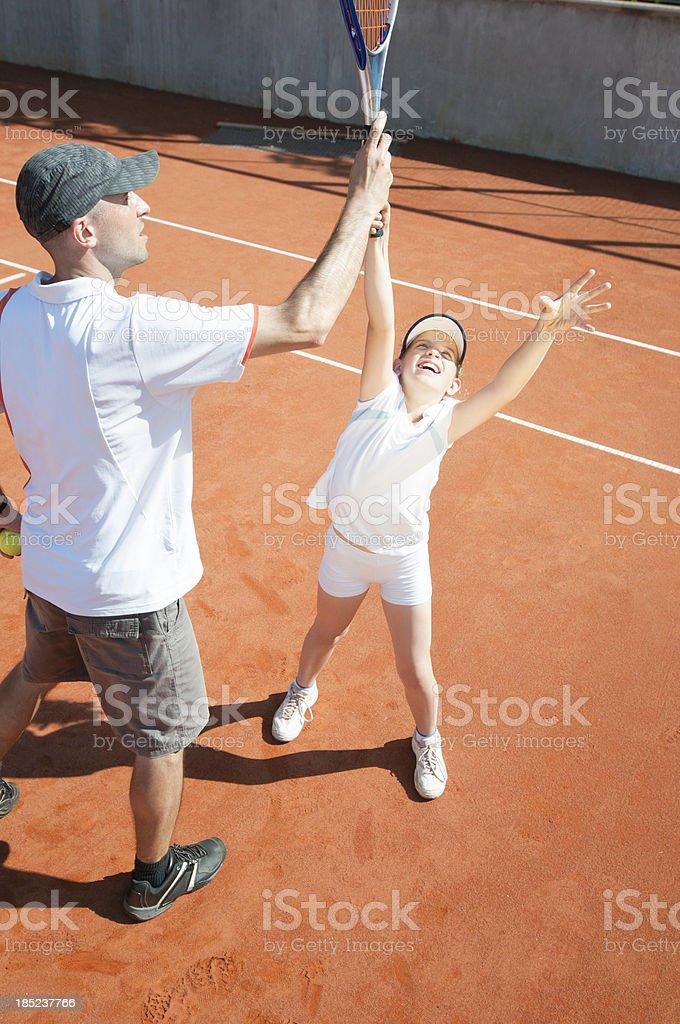 Junior female tennis player in training stock photo