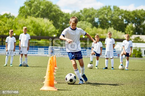 istock Junior Football Player at Practice 827507488