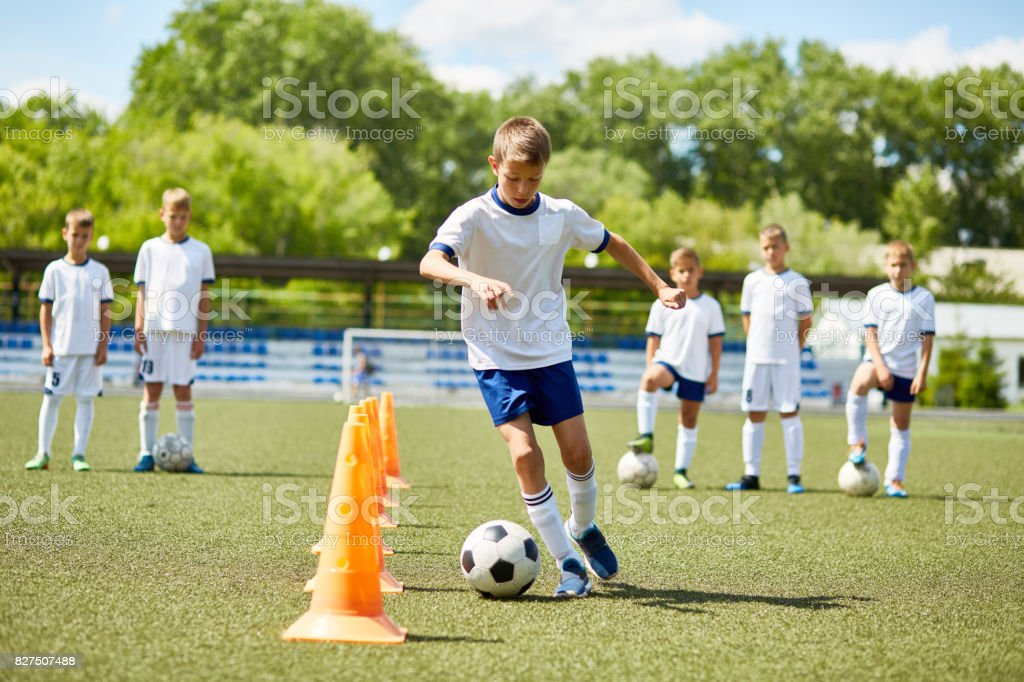 Junior Football Player at Practice stock photo