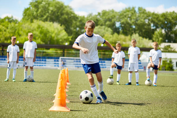 junior football player at practice - sport stock pictures, royalty-free photos & images