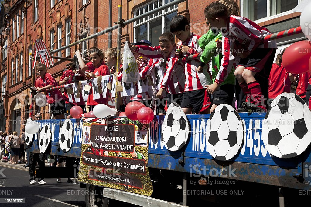 Junior football team on a carnival float royalty-free stock photo
