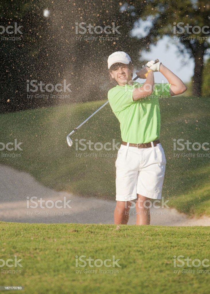 Junior Golfer Hits a Sand Shot royalty-free stock photo