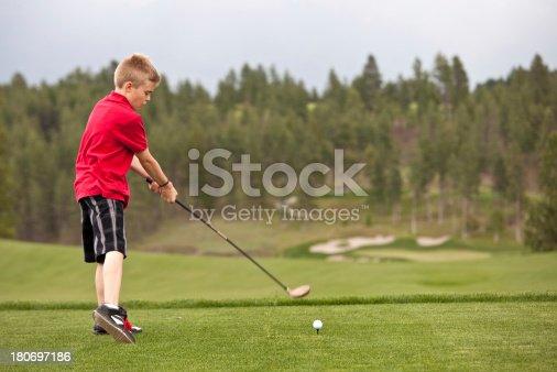 istock Junior Golfer Missing The Ball 180697186