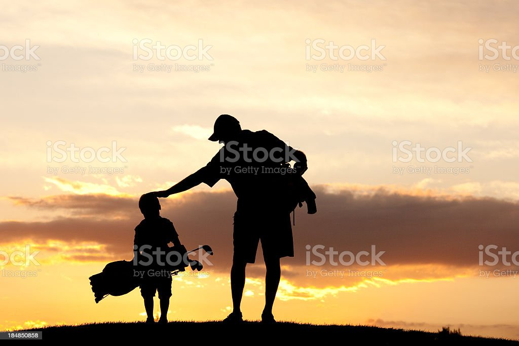 Junior Golfer With Father stock photo