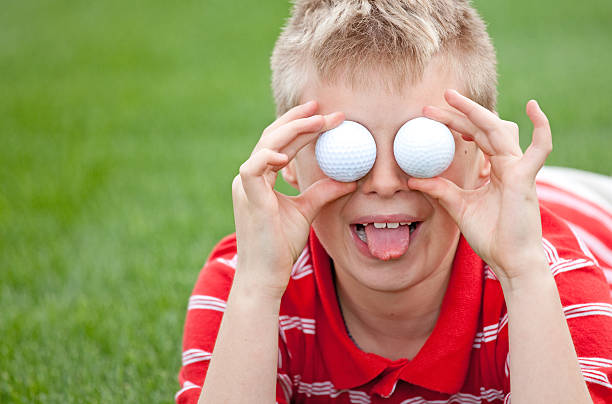 Junior Golfer With Golf Balls for Eyes stock photo