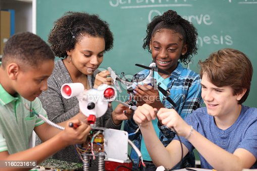 1016655140 istock photo Junior high age school students build robot in technology, engineering class. 1160231616