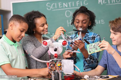 1016655140 istock photo Junior high age school students build robot in technology, engineering class. 1160231624