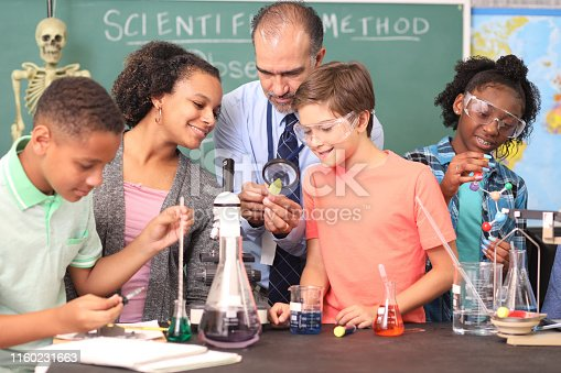 457224763 istock photo Junior high age school students conduct science experiments in classroom. 1160231663