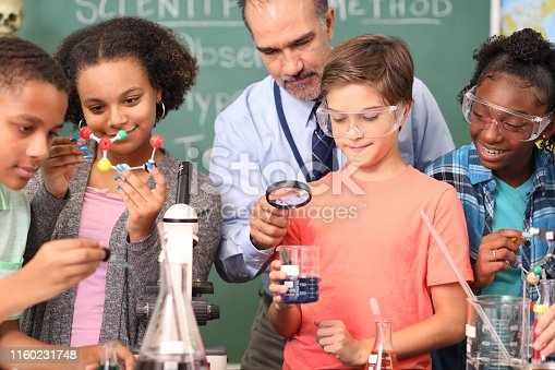 457224763 istock photo Junior high age school students conduct science experiments in classroom. 1160231748