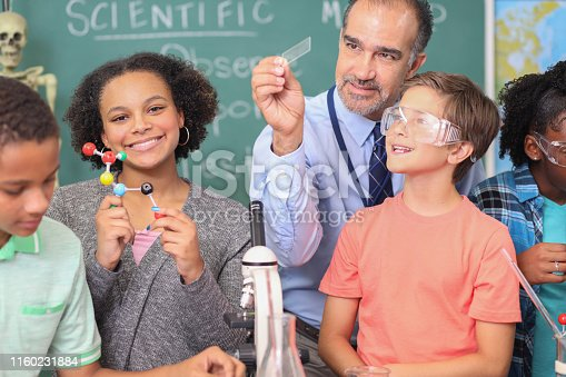 457224763 istock photo Junior high age school students conduct science experiments in classroom. 1160231884