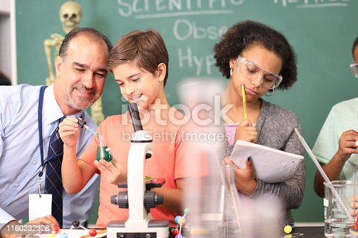 457224763 istock photo Junior high age school students conduct science experiments in classroom. 1160232328