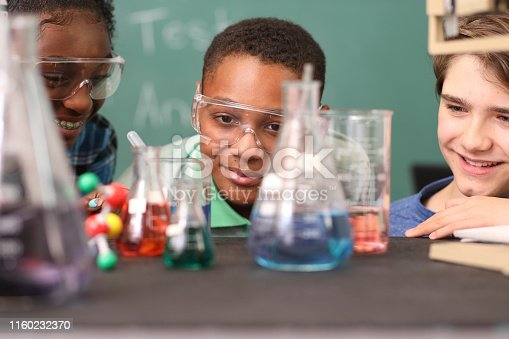 457224763 istock photo Junior high school age students conduct science experiments in classroom. 1160232370