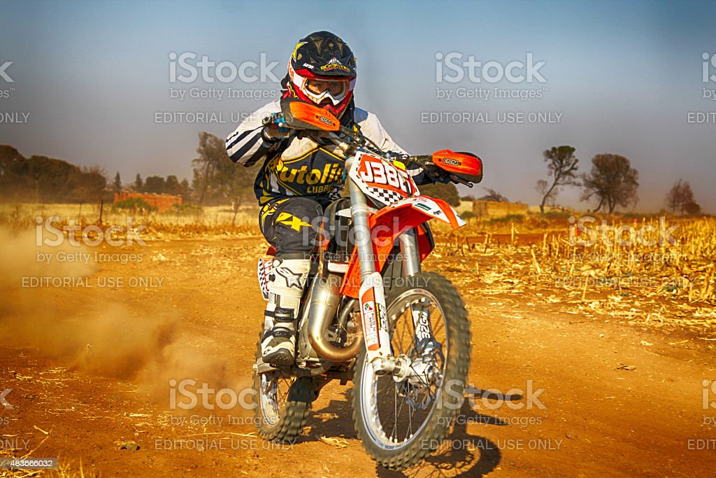 HD - Junior Motorbike kicking up trail of dust stock photo