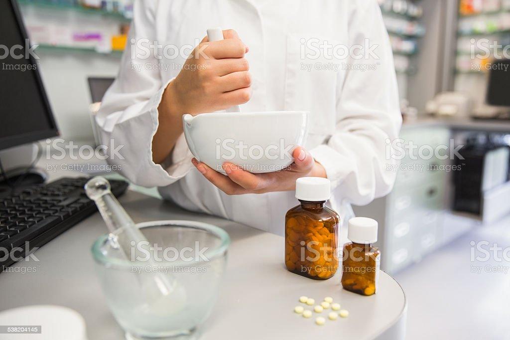 Junior pharmacist mixing a medicine stock photo