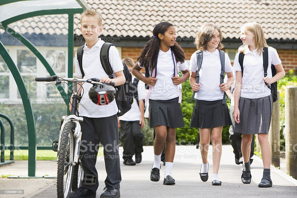 Junior school children leaving class royalty-free stock photo